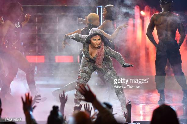 Rapper Lil Kim performs onstage at the 2019 BET Hip Hop Awards at Cobb Energy Performing Arts Centre on October 05 2019 in Atlanta Georgia