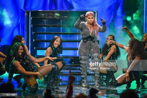 Rapper Lil Kim performs onstage at the 2019 BET Hip Hop Awards at Cobb Energy Performing Arts Centre on October 05, 2019 in Atlanta, Georgia.