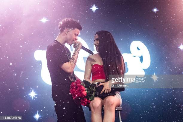 Rapper Lil Mosey performs live on stage with an audience member during the Northsbest Festival at the Showbox SoDo on April 27 2019 in Seattle...