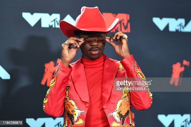 US rapper Lil Nas X poses in the press room during the 2019 MTV Video Music Awards at the Prudential Center in Newark New Jersey on August 26 2019
