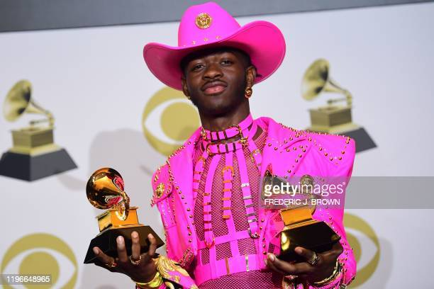 US rapper Lil Nas X poses in the press room with the awards for Best Music Video and Best Pop Duo/Group Performance during the 62nd Annual Grammy...