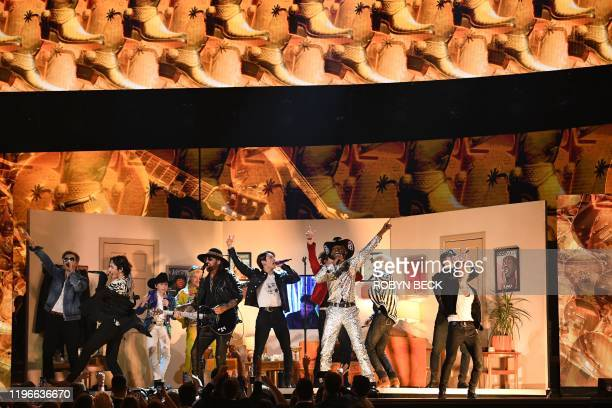 US rapper Lil Nas X South Korean boy band BTS and US singersongwriter Billy Ray Cyrus perform during the 62nd Annual Grammy Awards on January 26 in...
