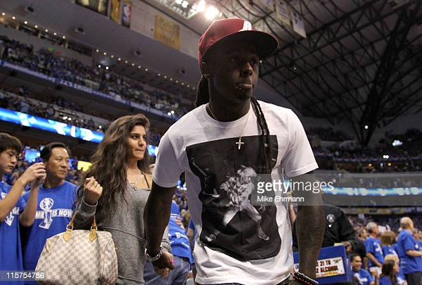 Rapper Lil Wayne and girlfriend Dhea Sodano attend Game Five of the 2011 NBA Finals between the Dallas Mavericks and the Miami Heat at American...