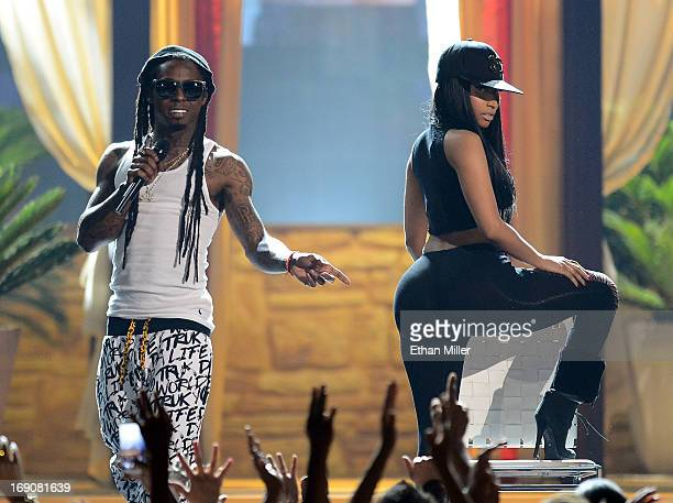 Rapper Lil Wayne and recording artist Nicki Minaj perform during the 2013 Billboard Music Awards at the MGM Grand Garden Arena on May 19 2013 in Las...