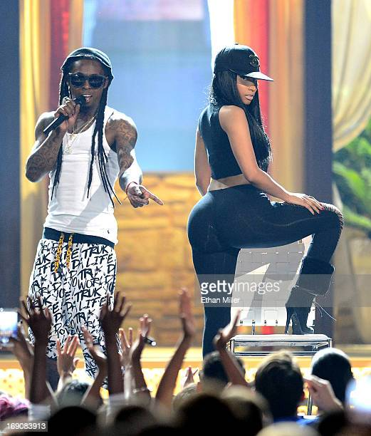 Rapper Lil Wayne and recording artist Nicki Minaj perform onstage during the 2013 Billboard Music Awards at the MGM Grand Garden Arena on May 19 2013...