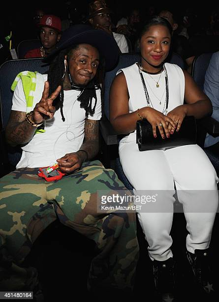 Rapper Lil Wayne and Reginae Carter attend the BET AWARDS '14 at Nokia Theatre LA LIVE on June 29 2014 in Los Angeles California