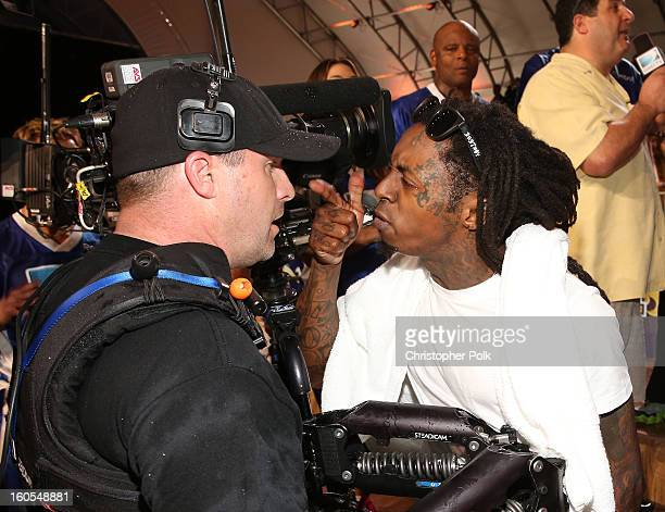 Rapper Lil Wayne attends DIRECTV'S Seventh Annual Celebrity Beach Bowl at DTV SuperFan Stadium at Mardi Gras World on February 2 2013 in New Orleans...