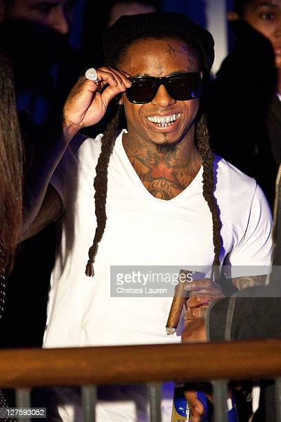 Rapper Lil' Wayne attends the AllStar Weekend Grand Finale with Nicki Minaj at BOULEVARD3 on February 20 2011 in Los Angeles California