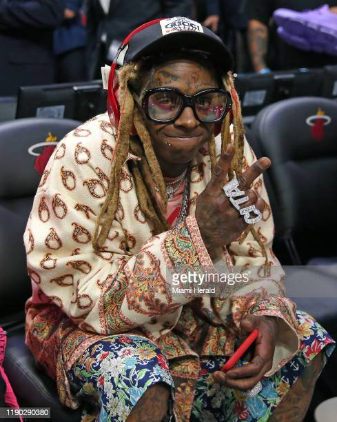 Rapper Lil Wayne is on hand as the Los Angeles Lakers visit the Miami Heat at the AmericanAirlines Arena in Miami on Friday, Dec. 13, 2019. The...