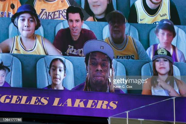 Rapper, Lil Wayne is seen as virtual fan during the game between the Los Angeles Lakers and the Oklahoma City Thunder at HP Field House at ESPN Wide...