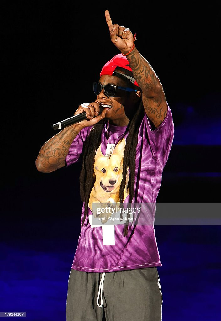 Rapper Lil Wayne performs during the 2013 America's Most Wanted Musical Festival at Verizon Wireless Amphitheatre on September 1, 2013 in Laguna Hills, California.