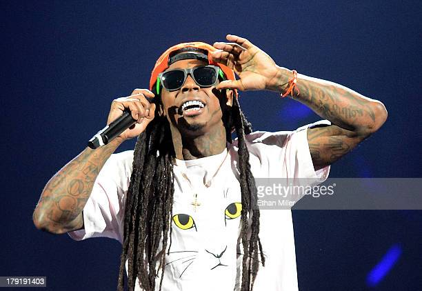 Rapper Lil Wayne performs during the America's Most Wanted Music Festival at the MGM Grand Garden Arena on August 31 2013 in Las Vegas Nevada
