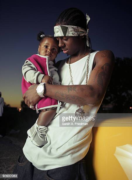 Rapper Lil' Wayne poses at a portrait session in 2000 for Blaze Magazine With daughter Reginae