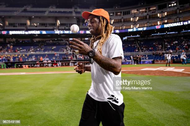 Rapper Lil Wayne throws out the ceremonial first pitch before the game between the Miami Marlins and the Washington Nationals at Marlins Park on May...