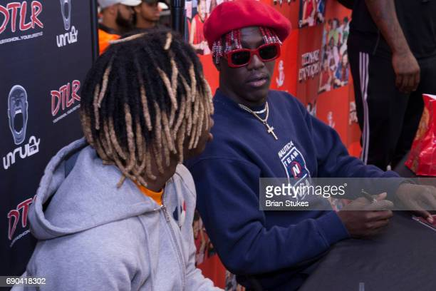 Lil yachty meet greet stock photos and pictures getty images rapper lil yachty signs copies of his teenage emotions album at dtlr columbia mall m4hsunfo