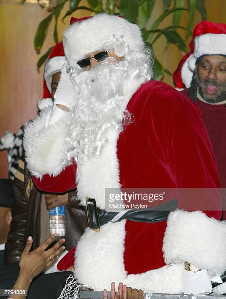 Rapper LL Cool J dressed as Santa Claus helps celebrate at a party for 250 disadvantaged youths December 8 2003 in New York City The event which also...