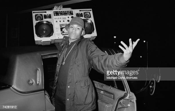 Rapper LL Cool J holds a boombox outside a concert circa 1986