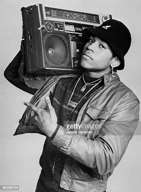 Rapper LL Cool J real name James Todd Smith carries a boombox upon his right shoulder while posing for a studio portrait 1985 New York He is wearing...
