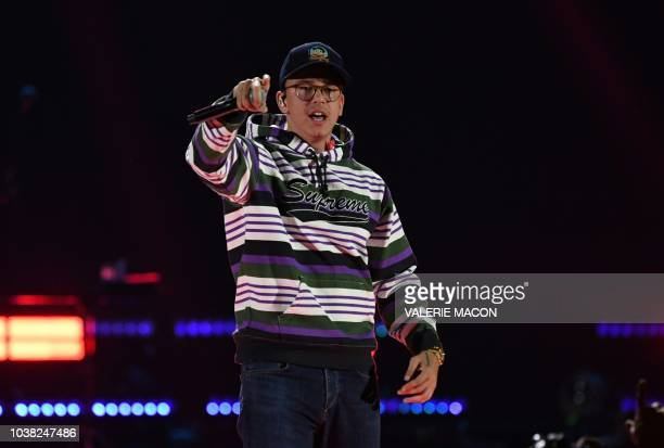 Rapper Logic performs on stage during the iHeartRadio Music Festival at the TMobile arena in Las Vegas Nevada on September 22 2018