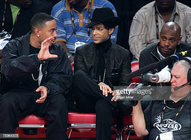 Rapper Ludacris musician Prince and actor Dave Chappelle watch the game during the 2007 NBA All Star Game held at the Thomas Mack Center on February...