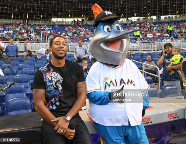 Rapper Ludacris poses for a photo with Billy the Marlin before the game between the Miami Marlins and the Boston Red Sox at Marlins Park on April 2...