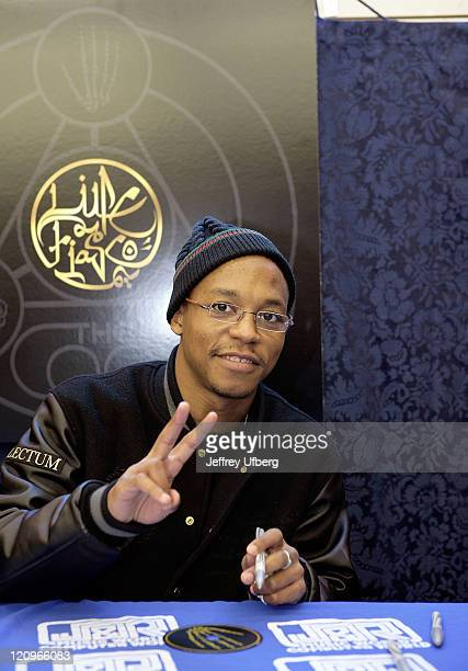Rapper Lupe Fiasco flashes a peace sign while signing copies of his CD The Cool at JR Music and Co February 2 2008 in New York City