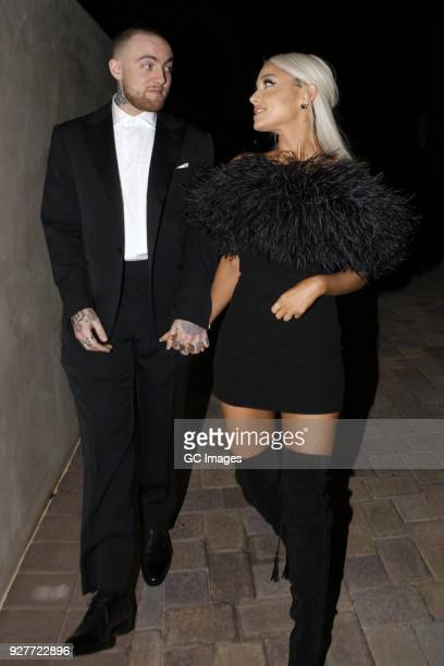 Rapper Mac Miller and singer Ariana Grande are seen attending an Oscar party on March 4 2018 in Los Angeles California