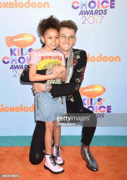 Rapper Machine Gun Kelly and Casie Colson Baker arrive at the Nickelodeon's 2017 Kids' Choice Awards at USC Galen Center on March 11 2017 in Los...