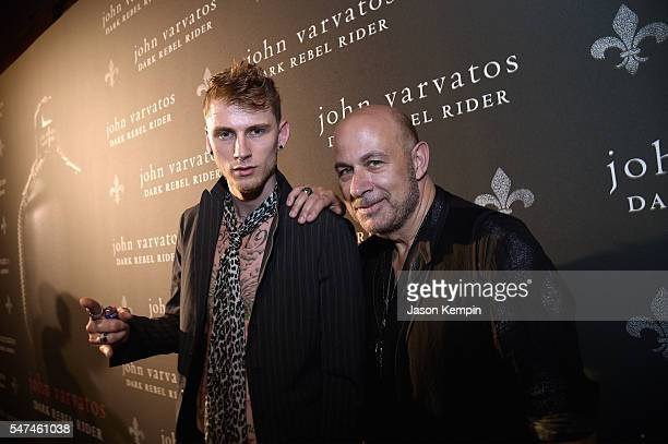 Rapper Machine Gun Kelly and designer John Varvatos attend the John Varvatos Spring/Summer 2017 Fashion Show after party celebrating the launch of...