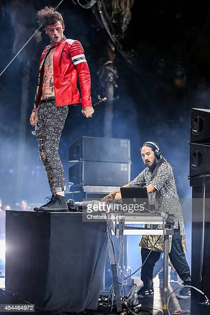 Rapper Machine Gun Kelly and DJ Steve Aoki perform during day 2 of the Made in America Festival at Los Angeles Grand Park on August 31 2014 in Los...