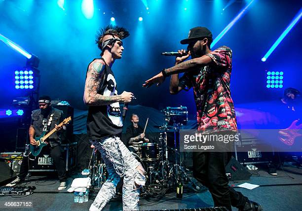 Rapper Machine Gun Kelly and Slim Gudz perform at The Fillmore Detroit on October 3 2014 in Detroit Michigan
