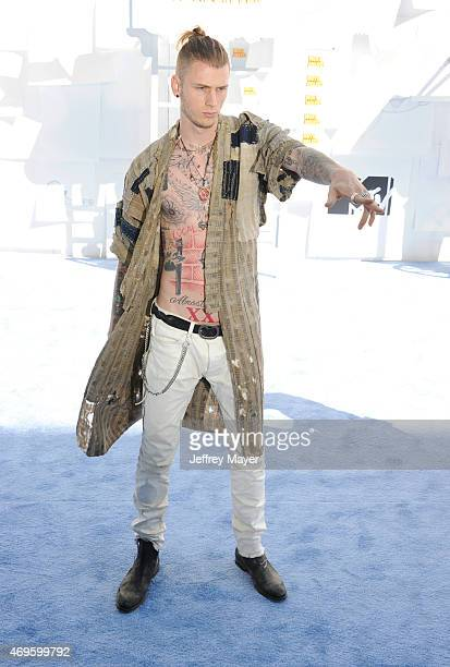 Rapper Machine Gun Kelly arrives at the 2015 MTV Movie Awards at Nokia Theatre L.A. Live on April 12, 2015 in Los Angeles, California.