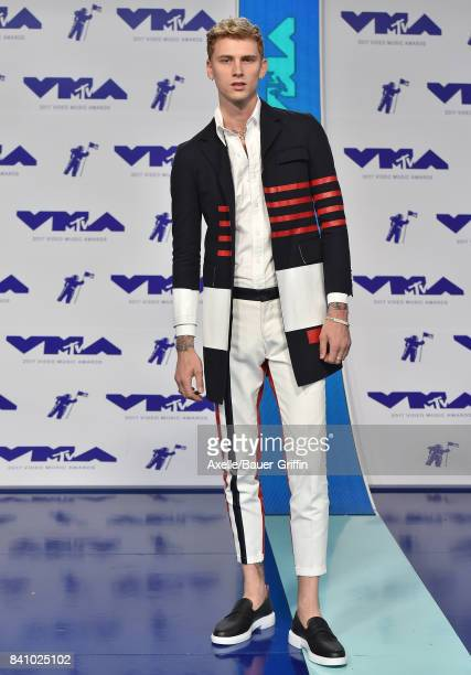 Rapper Machine Gun Kelly arrives at the 2017 MTV Video Music Awards at The Forum on August 27 2017 in Inglewood California