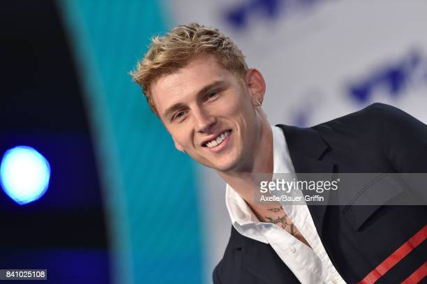 Rapper Machine Gun Kelly arrives at the 2017 MTV Video Music Awards at The Forum on August 27, 2017 in Inglewood, California.
