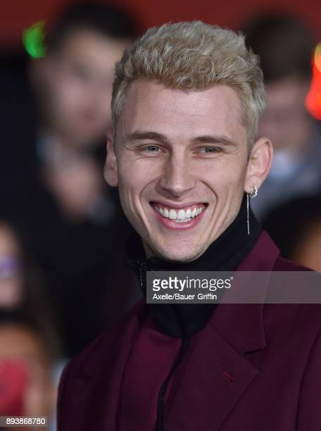 Rapper Machine Gun Kelly arrives at the premiere of Netflix's 'Bright' at Regency Village Theatre on December 13 2017 in Westwood California
