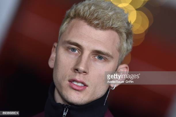 Rapper Machine Gun Kelly arrives at the premiere of Netflix's 'Bright' at Regency Village Theatre on December 13, 2017 in Westwood, California.