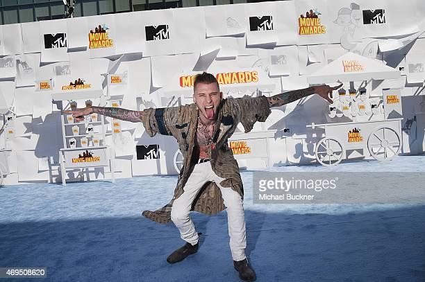 Rapper Machine Gun Kelly attends The 2015 MTV Movie Awards at Nokia Theatre LA Live on April 12 2015 in Los Angeles California