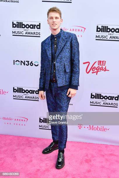 Rapper Machine Gun Kelly attends the 2017 Billboard Music Awards at TMobile Arena on May 21 2017 in Las Vegas Nevada