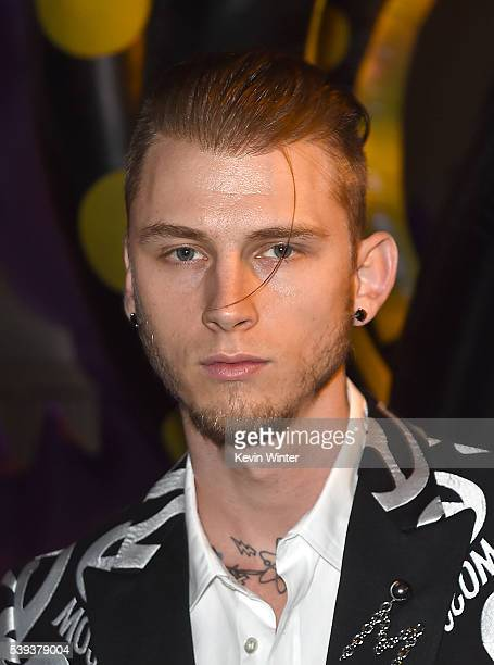Rapper Machine Gun Kelly attends the Moschino Spring/Summer 17 Menswear and Women's Resort Collection during MADE LA at LA LIVE Event Deck on June 10...