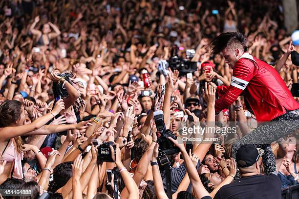 Rapper Machine Gun Kelly performs during day 2 of the Made in America Festival at Los Angeles Grand Park on August 31 2014 in Los Angeles California