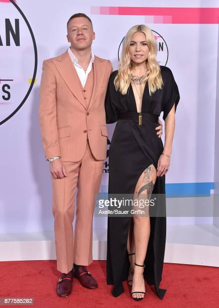 Rapper Macklemore and singersongwriter Skylar Grey arrive at the 2017 American Music Awards at Microsoft Theater on November 19 2017 in Los Angeles...
