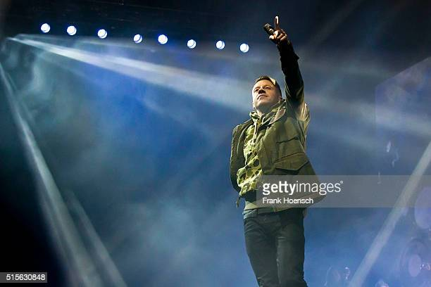 Rapper Macklemore of Macklemore Ryan Lewis performs live during a concert at the Mercedes Benz Arena on March 14 2016 in Berlin Germany