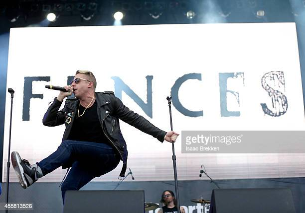 Rapper Macklemore performs onstage during the 2014 iHeartRadio Music Festival Village on September 20 2014 in Las Vegas Nevada