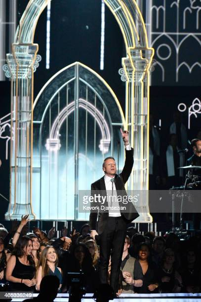Rapper Macklemore performs onstage during the 56th GRAMMY Awards at Staples Center on January 26 2014 in Los Angeles California