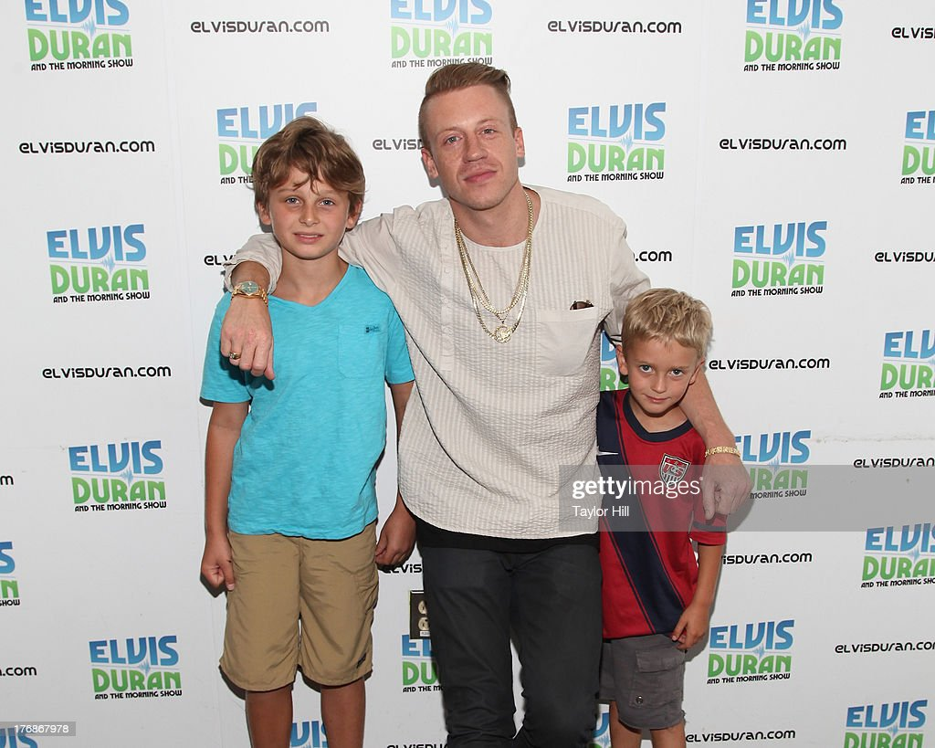 Rapper Macklemore poses with young fans at 'The Elvis Duran Z100 Morning Show' at Z100 Studio on August 16, 2013 in New York City.