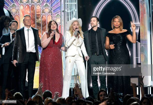 Rapper Macklemore singers Mary Lambert and Madonna musician Ryan Lewis and Queen Latifah perform onstage during the 56th GRAMMY Awards at Staples...