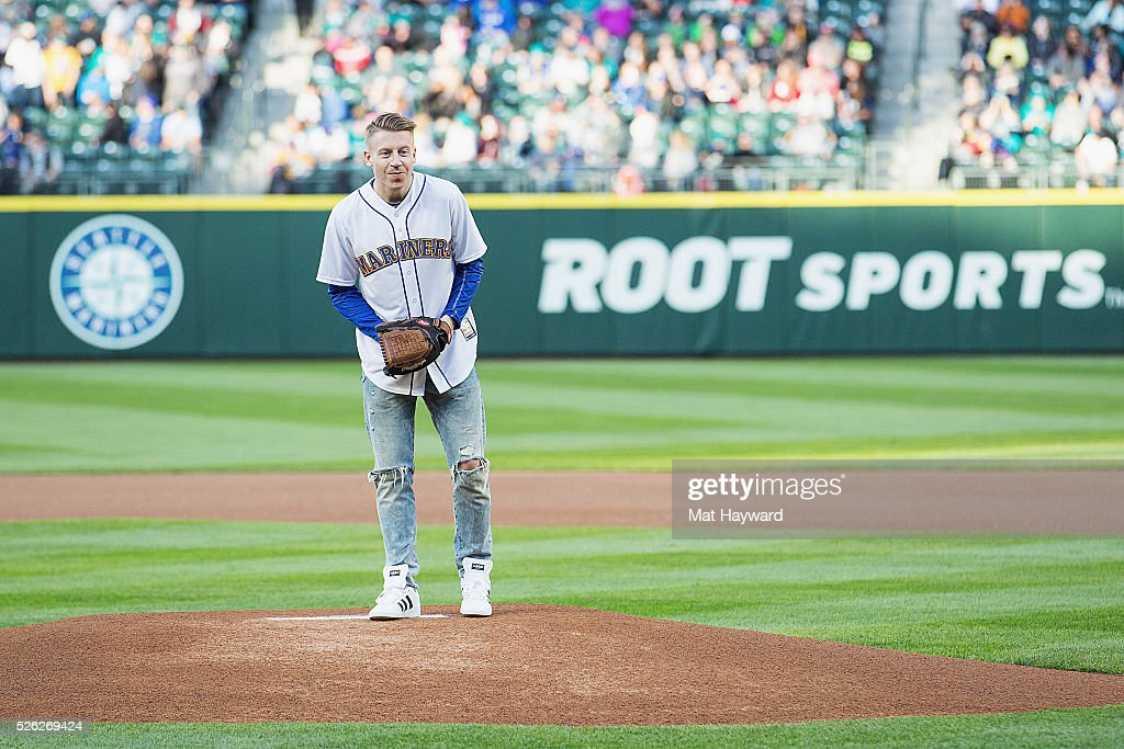 "Macklemore Throws Out First Pitch At The Seattle Mariners' Game At Safeco Field For ""Bumbershoot Night"""