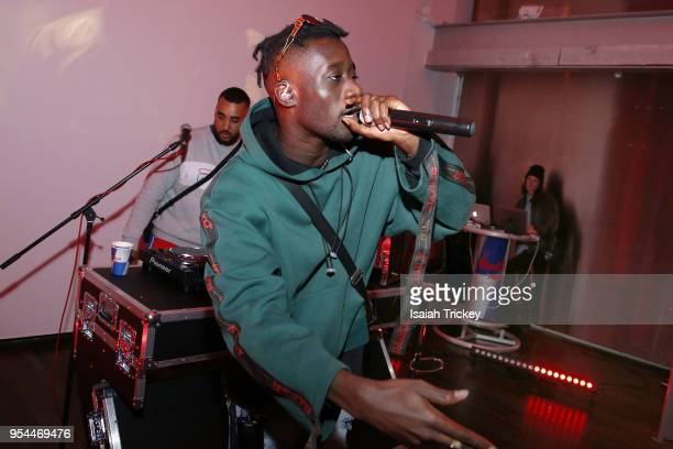 Rapper Manu Crook$ and DJ Ziggy perform during Rap N' Roll & Mood Forever Present Manu Crook$ at Red Bull 381 Projects on May 3, 2018 in Toronto,...