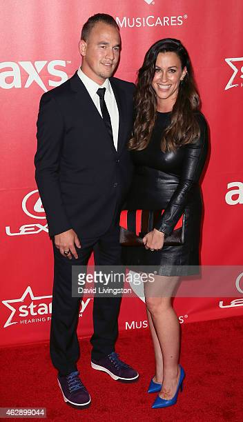 Rapper Mario Treadway and wife recording artist Alanis Morissette attend the 2015 MusiCares Person of the Year Gala honoring Bob Dylan at the Los...