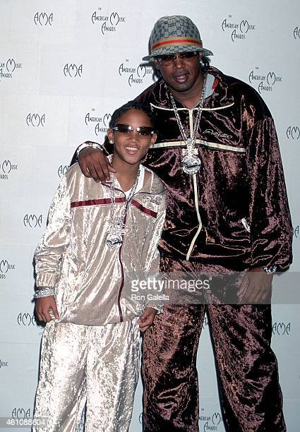 Rapper Master P and son rapper Lil' Romeo attend the 29th Annual American Music Awards on January 9 2002 at the Shrine Auditorium in Los Angeles...